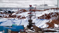 Well pad with a oil well Christmas tree equipment video