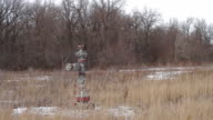 Well pad with oil well Christmas tree equipment video