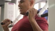 Wellness and training in fitness club, hispanic man exercising video