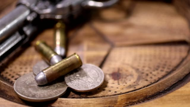 Western six shooter, bullets and coins video