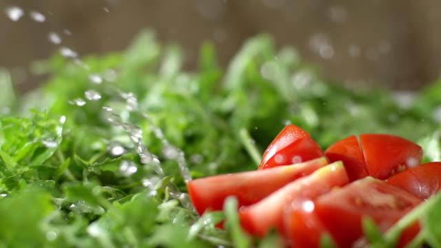 SLO MO Wet Chopped Tomato Falls On Arugula video