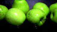 Wet green apples and water ripple super slow motion shot. Freshness concept video