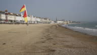 Weymouth beach and waves with flag flying in breeze Dorset UK video