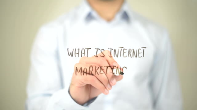 What is Internet Marketing, Man Writing on Transparent Screen video
