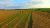 AERIAL VIEW. A Wheat Field Being Harvested video