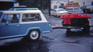 1972: 6 wheel amphibious all terrain vehicle being towed. video