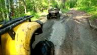Wheel ATV drives into a deep mud puddle video