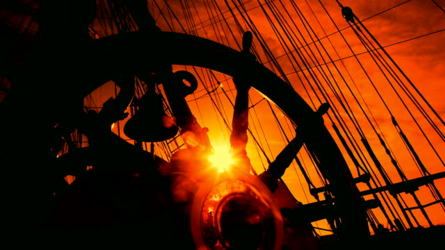 wheel of an old sailing ship at sunset video