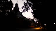 3 Wheelers Tuk Tuk passes near the temple in Chiang Mai video