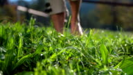 While walking on the grass drops of water atomising around video
