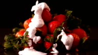 Whipped cream pouring onto strawberries video