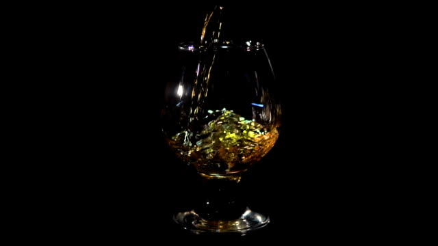 Whiskey Pouring into Glass on Black video