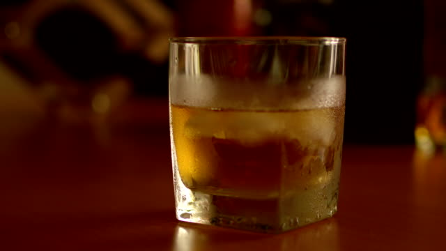 whisky glass with ice video