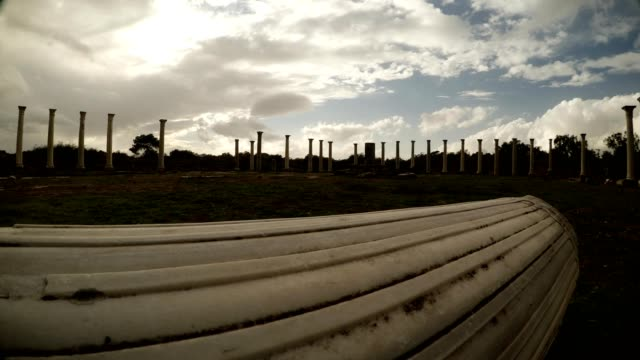 White antique column on ground behind Colonnade of Roman Agora Salamis Famagusta video