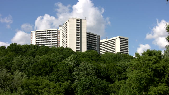 White apartments on green hillside. video