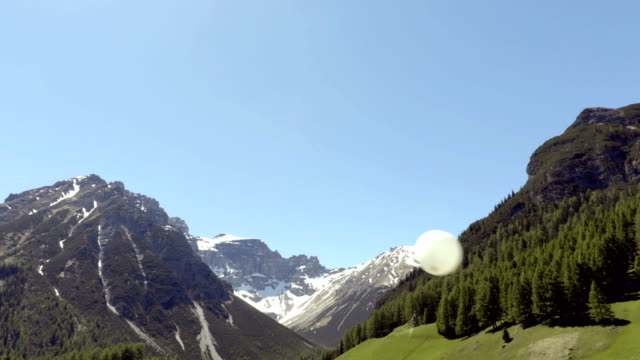 White balloon on the wind with the alps on the background video