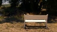 White bench placed in rural area video
