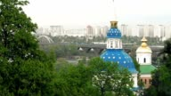 White blue and gold orthodox church in trees video