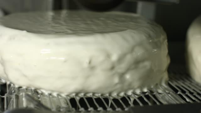 White cakes under air stream. video