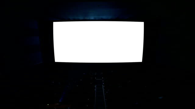 White cinema screen with projector light and audience. video