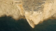 AERIAL White cliff along the sea in sunset video