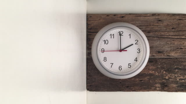 white clock on the wooden wall video