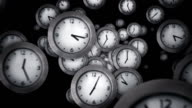 White clocks flying. Black background. Loopable. video