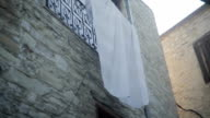 White Cloth Hanging On The Facade Of The Building video