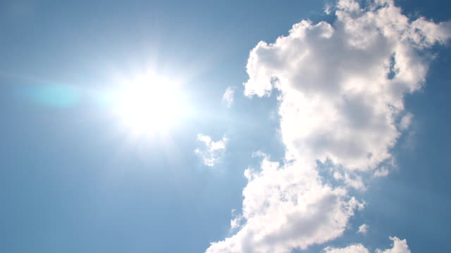White clouds disappear in the hot sun on blue sky video