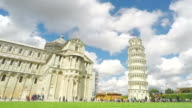 White clouds flying over Leaning Tower of Pisa, tourist sightseeing in Italy video