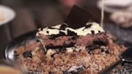 White cream sauce dripping on brownie blondie dessert video