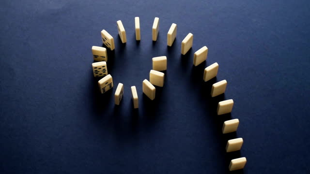 White Dominoes Falling in Chain Reaction. Domino Effect video