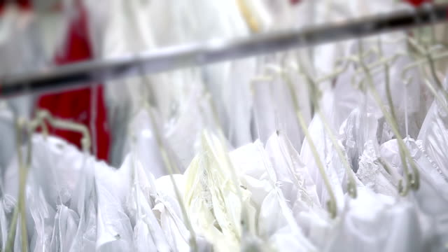 White dresses on hanger in the store video