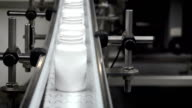 White Drug Bottles on Conveyor Moving Towards Camera video