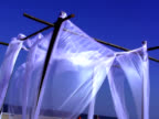 White fabric blowing in the wind video