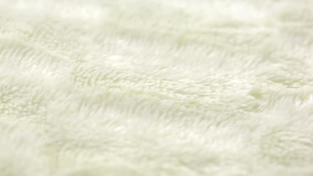 White fur for background or texture. warm blanket video