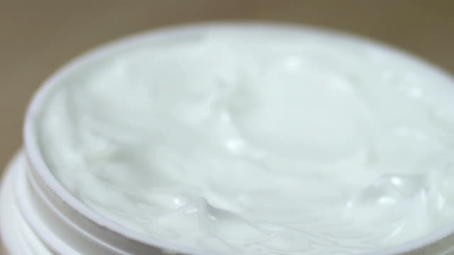 White gentle cosmetic cream Fingered,macro closeup video