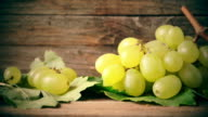 white grapes  on wooden table video