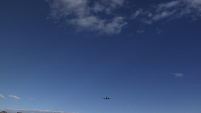 White Jet Plane passes overhead landing, 4:2:2 1080i video
