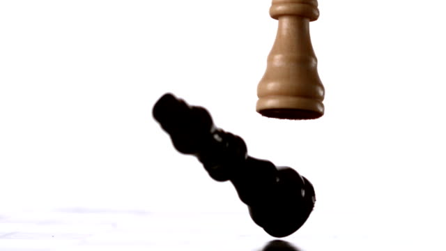White king knocking over black one video