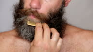 White Man Taking Care of his Lush Beard and Mustache video