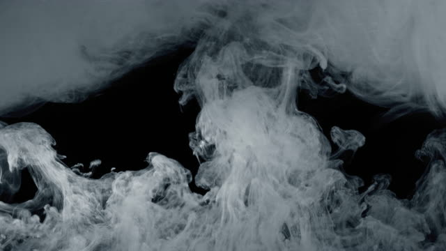 White paint isolated on black background video