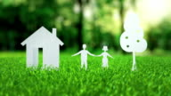 White paper house family tree animation on green nice summer grass mortgage concept video
