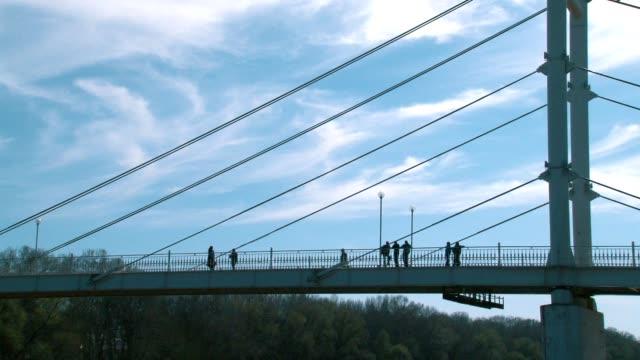 White pedestrian bridge crossing the Ural river video