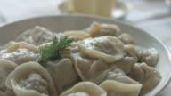 White plate of hot homemade dumplings video