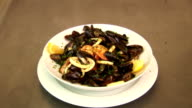 White plate with prepared mussels in white wine with lemon, prawns and basil. Fresh restaurant dish video
