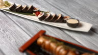 White plate with sushi rolls. video