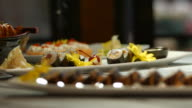 White plates with sushi. video