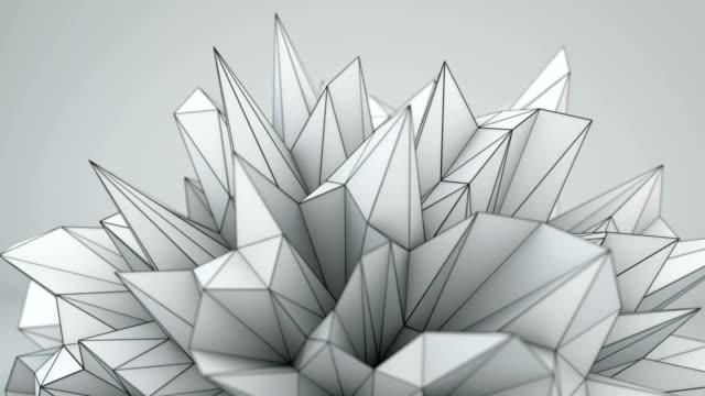White polygonal shape in studio seamless loop 3D render video