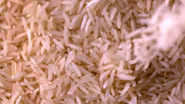 White rice pouring onto more video